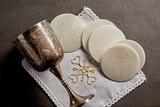 Silver chalice cup and Sacramental bread - 189037156