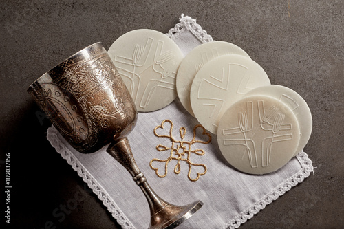 Silver chalice cup and Sacramental bread