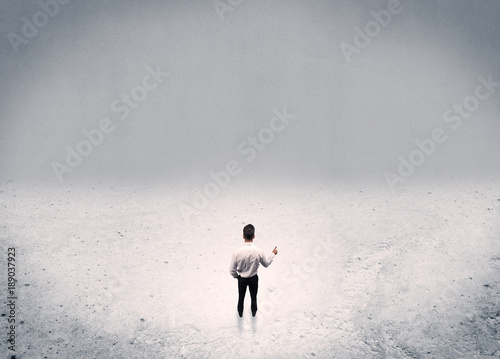 Businessman standing in urban empty space
