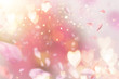 Leinwanddruck Bild - Abstract composition for Women's Day. Pink flower petals flying with hearts symbols.