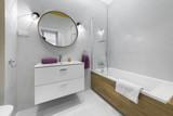Modern bathroom with oval mirror - 189053969