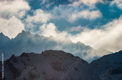 Foto op Aluminium Donkergrijs panorama of snowy Tatra Mountains in clouds, poland