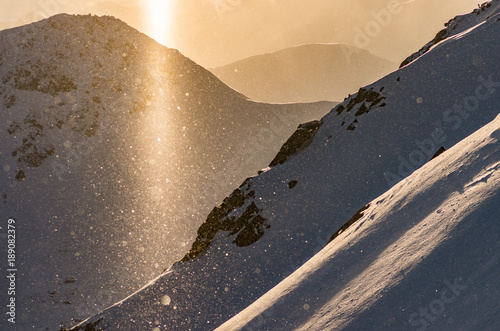 Sun pillar during snowfall, Tatra mountains, Poland