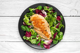 grilled chicken breast with mixed salad on a black plate - 189086557