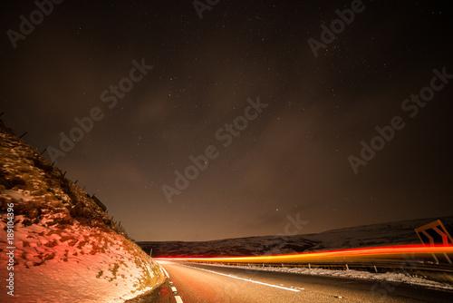 Foto op Plexiglas Nacht snelweg snake pass stars