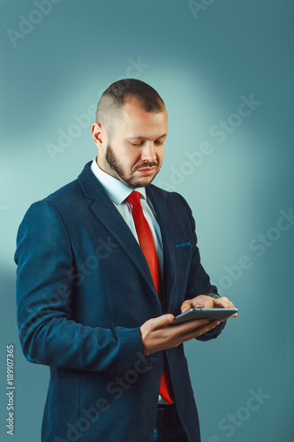 Young contemprary businessman, overlooking pensive - business, serious, technology concept
