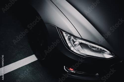 Fototapeta Modern car wrapped in grey color matte vinyl