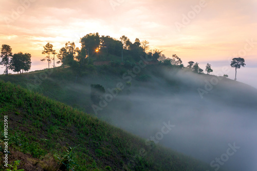 Foto op Plexiglas Grijs Mountain and fog at morning time with sun ray, beautiful landscape