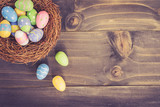 Colorful easter eggs in neat on plank wooden background with space. - 189127532