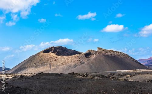 Fotobehang Blauw Volcano El Cuervo, Lanzarote, Canary Islands, Spain