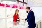 Man buying a valentines gift in a jewelry store