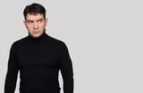 serious handsome man wearing black turtleneck