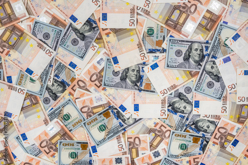 50 wuro and 100 dollar banknotes as background