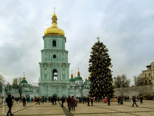 Fotobehang Kiev Kiev, Ukraine - December 31, 2017: Saint Sophia's Cathedral and the main Christmas tree of Ukraine 2018 on St. Sophia Square the day before the New Year