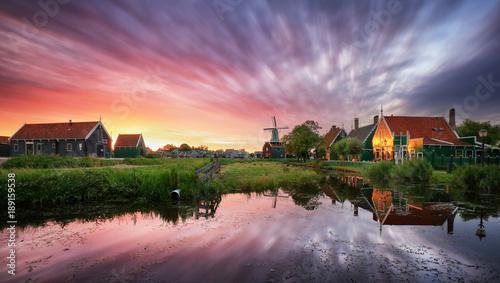 Fotobehang Purper Dutch landscape with windmill at dramatic sunset, Zaandam, Amsterdam, Netherlands