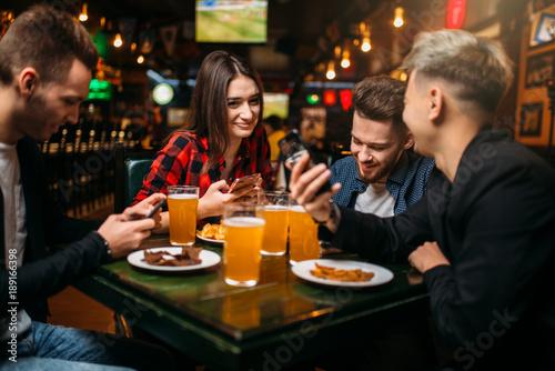 Fun friends in a sport bar, victory celebration