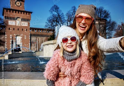 Fotobehang Milan happy mother and child travellers in Milan, Italy taking selfie