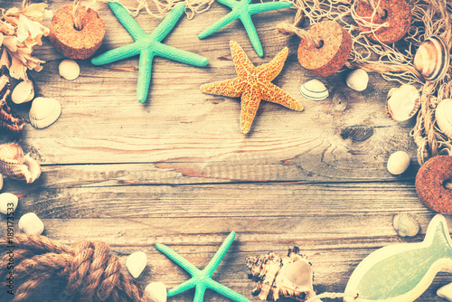 Summer holiday frame with seashells and fishing net. Vacation background