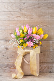 Beautiful spring flowers on wooden background - 189175991