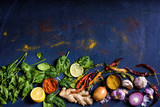 top view of tasty healthy herbs, vegetables and spices on blue - 189184990