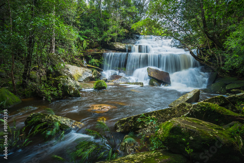 Fotobehang Thailand Waterfall in the tropical rainforest landscape