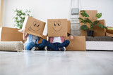 Funny young couple enjoy and celebrating moving to new home - 189208776