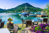 Beautiful view over terrace near the beach with flowers on table in Nydri villaga, seaport of Lefkada, in Greece - 189212731