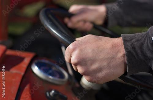 Fotobehang Trekker Farmer driving tractor