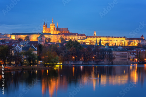 Foto op Canvas Praag Prague, view of illuminated Prague castle (Prazsky Hrad) with reflection in the water, night scenic cityscape, world famous historical heritage of Czech Republic