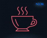 Neon light. Coffee cup line icon. Hot drink sign. Cappuccino symbol. Glowing graphic design. Brick wall. Vector