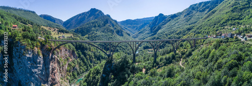 Fotobehang Olijf Panoramic aerial view of the Djurdjevica Bridge over the Canyon of the Tara River. Montenegro.