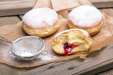 Traditional Polish donuts on wooden background. Tasty doughnuts with jam. - 189236531