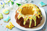 Easter Bundt cake with colorful topping and Easter Cookies - 189251362
