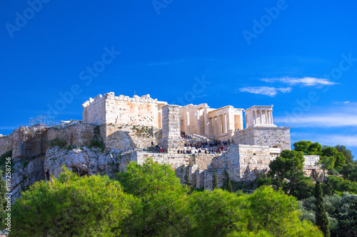 Foto Murales Acropolis with Parthenon. View through a frame of green plants, trees and ancient marbles, Athens, Greece.