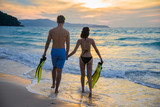 couple lover enjoy on the beach with fin flipper after diver in the sea, anniversary and cebrabrate honeymoon, valentine occasion - 189305359
