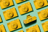 Vintage yellow cameras laying on green background - 189309597