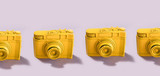 Yellow cameras standing in a row - 189309907