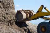 Wheel excavator digging  gravel pile for loading in the truck - 189316985