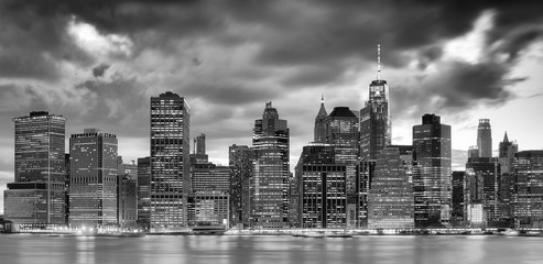 Black and white panoramic picture of the New York City skyline at dusk, USA.