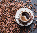 Cup of coffee surrounded by coffee beans. Top view. - 189344322