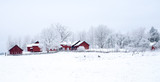 Farm barn in a cold winter landscape with snow and frost - 189348502
