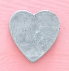 Valentine's day concept. heart over pastel pink background. Top view.