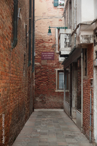 Foto op Canvas Smal steegje Buildings and houses in Venice