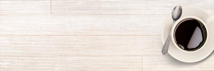 Tasse Kaffee / Espresso auf Holztisch - Hintergrund / Banner © reichdernatur