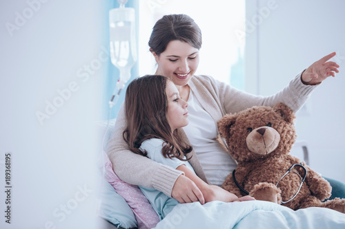 Sister taking care of child