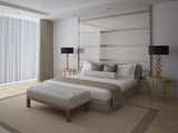 Modern comfortable bedroom with a large stylish bed and a white background. - 189372542