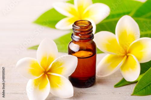 Fotobehang Plumeria Plumeria Essential Oil Perfume and yellow plumeria flowers on the wooden table