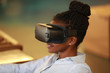 Content black woman in VR headset