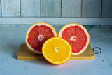 Cut the oranges and grapefruits on a wooden cutting Board, light background