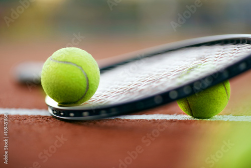 Sport. Tennis Balls And Racket On Court
